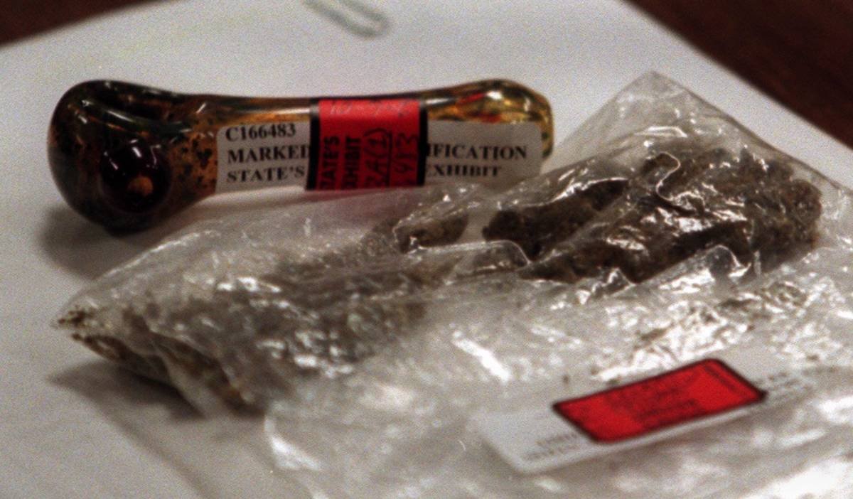 A pipe and a bag of marijuana that was found in Jessica Williams' van lays on the district atto ...