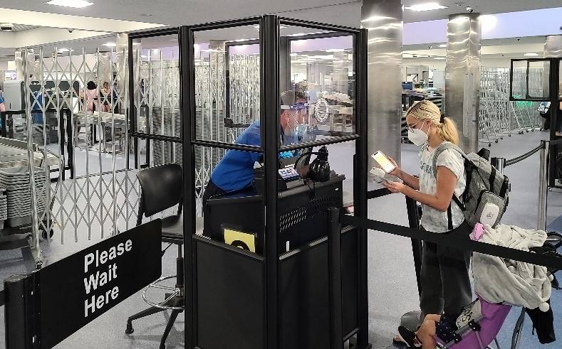 Acrylic barriers have been installed in security checkpoints at McCarran International Airport ...