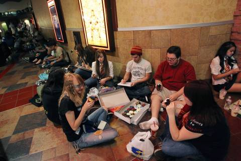 RJ FILE*** JASON BEAN/LAS VEGAS REVIEW-JOURNAL A group of friends share cupcakes and card gam ...