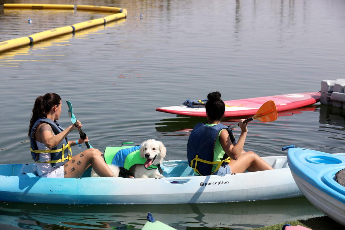 Ashley, left, and Natasha Rupe of Las Vegas kayak with their dog, Steve, during Bring Your Dog ...