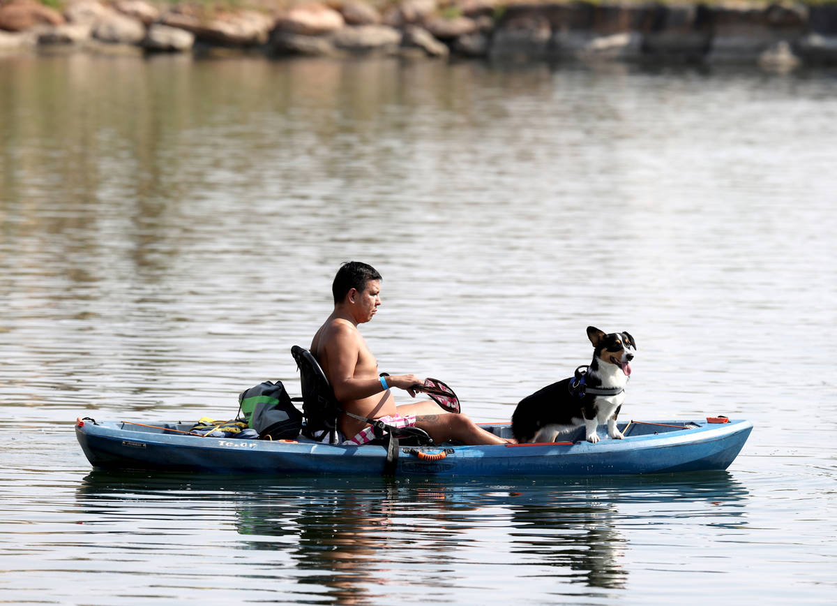 Carlos Portillo of Las Vegas kayaks with Devon Anthony during Bring Your Dog to the Lake Day at ...