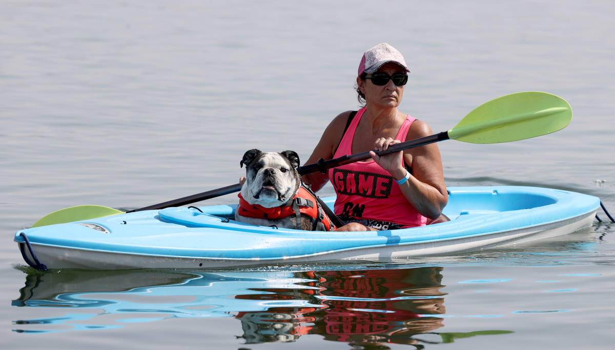 Kimberly Jones of Las Vegas kayaks with Brutus during Bring Your Dog to the Lake Day at Lake La ...
