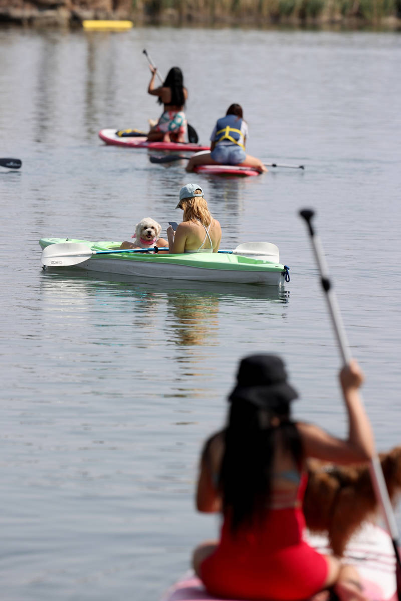 Jesi Shive of Las Vegas, center, kayaks with her friend's dog, Stella, during Bring Your Dog to ...