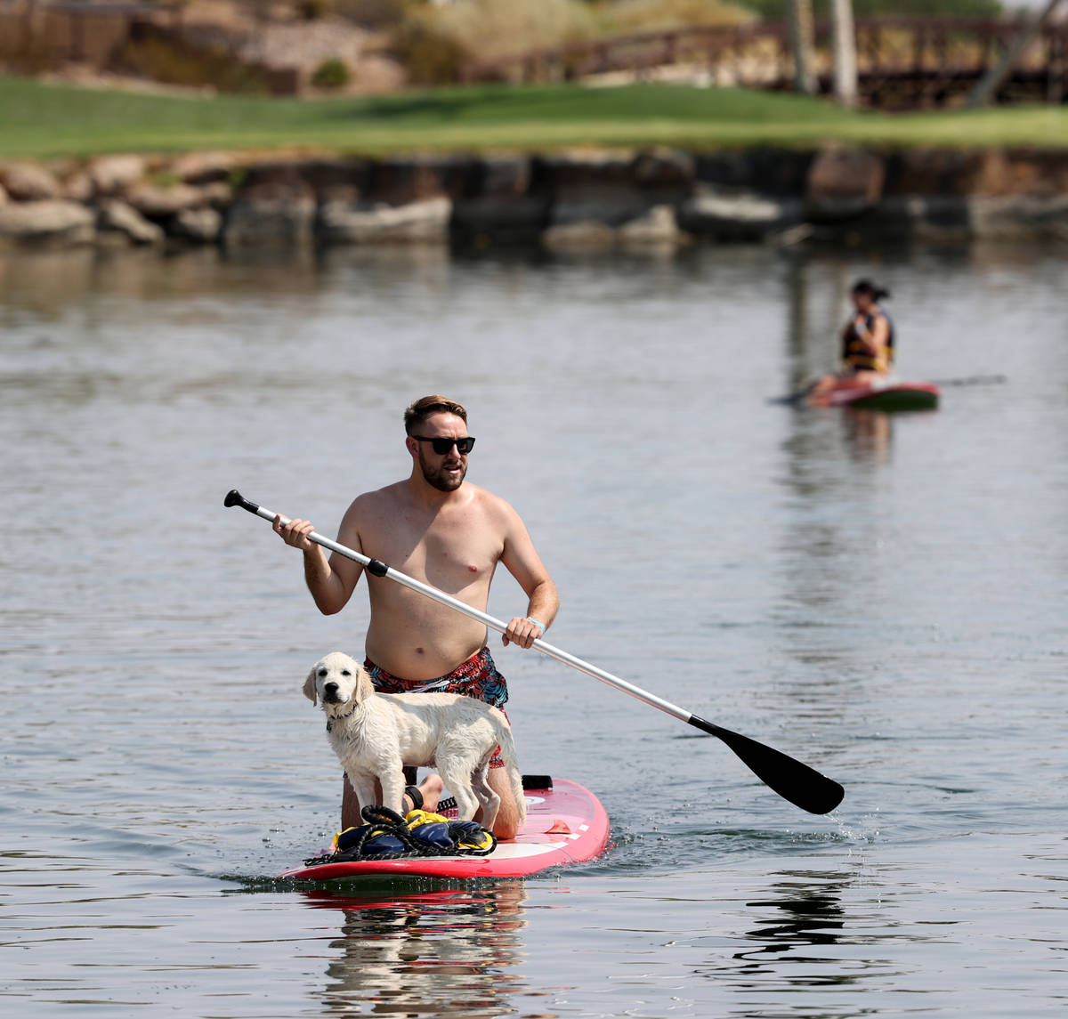 Patrick Kawka of Las Vegas paddleboards with his dog, Zuko, during Bring Your Dog to the Lake D ...
