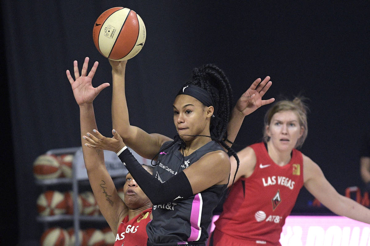 Dallas Wings forward Satou Sabally passes the ball in front of Las Vegas Aces center A'ja Wilso ...