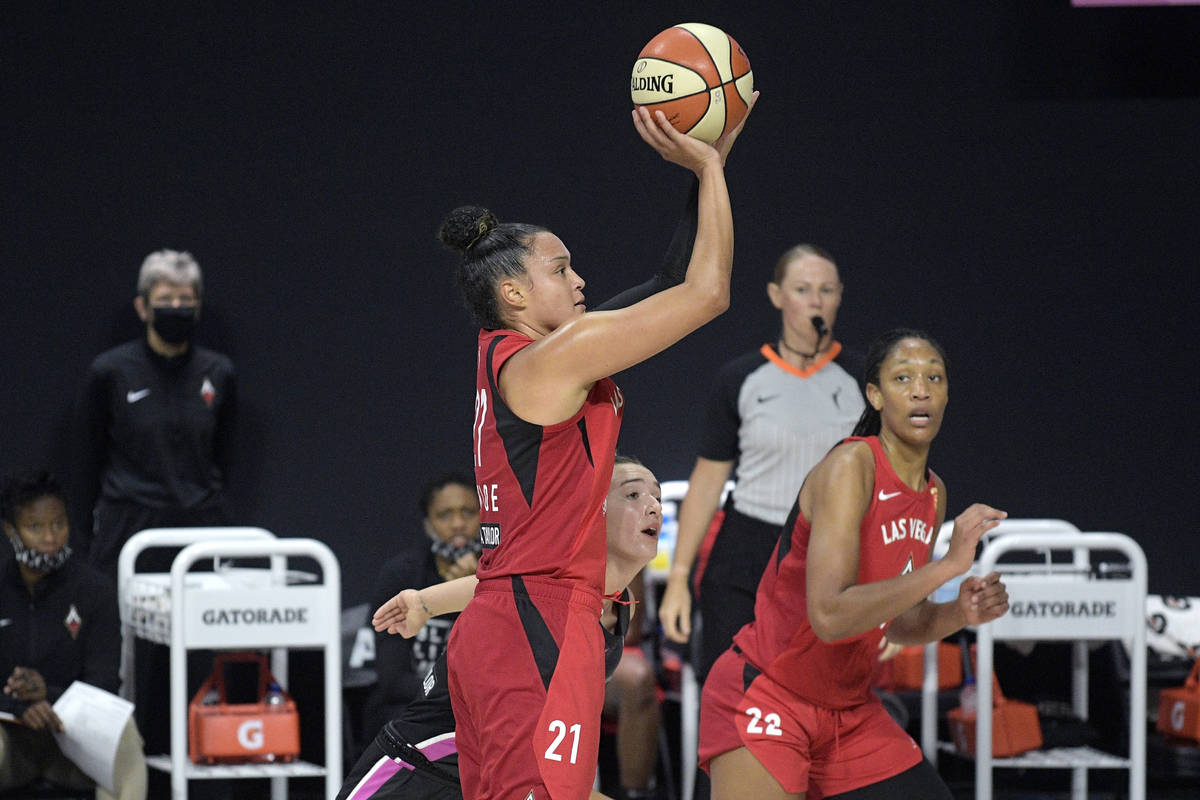 Las Vegas Aces guard Kayla McBride (21) goes up for a shot in front of Dallas Wings guard Marin ...