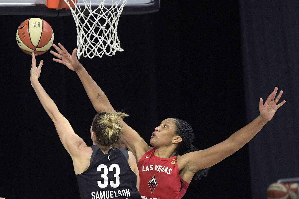 Dallas Wings guard Katie Lou Samuelson (33) goes up for a shot in front of Las Vegas Aces cente ...