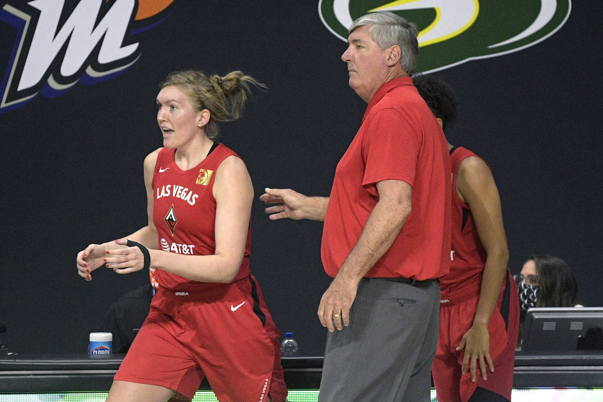 Las Vegas Aces head coach Bill Laimbeer sends center Carolyn Swords, left, into the game during ...
