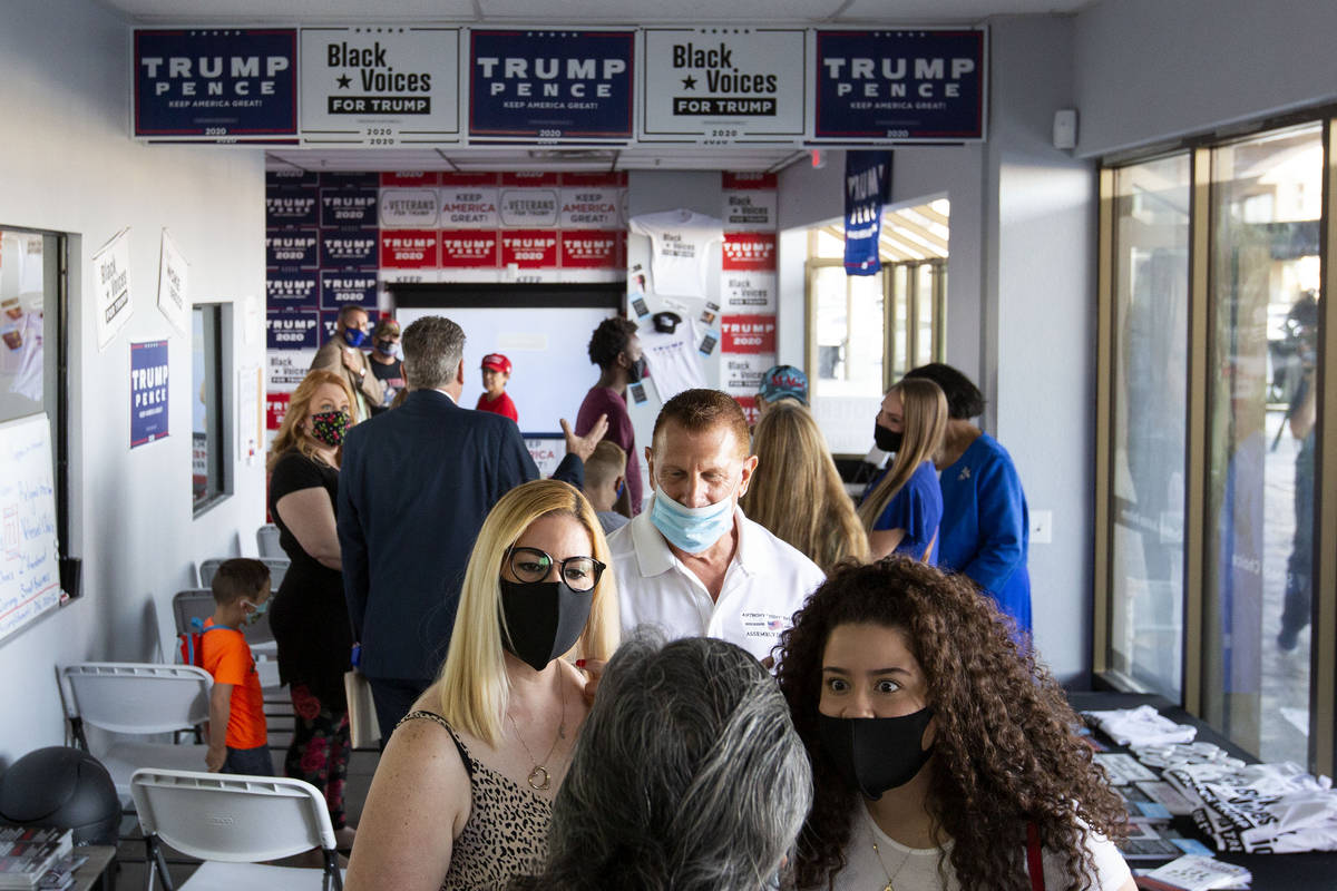 Trump supporters mingle before a watch party for the Republican National Convention on Tuesday, ...