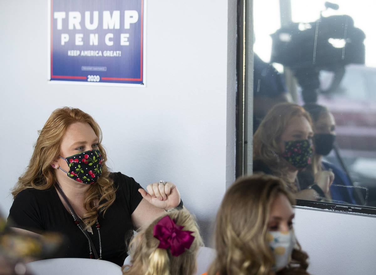 Trump supporter Tisheena Hollis, who brought her 5 children along, asks Sen. Scott Hammond, R-L ...
