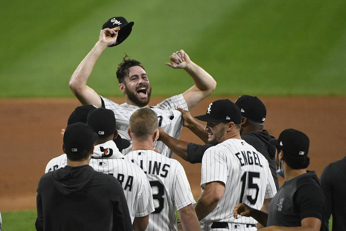 Chicago White Sox starting pitcher Lucas Giolito, facing camera, and teammates celebrate his no ...