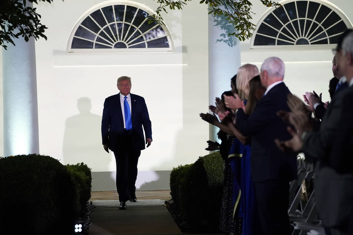 President Donald Trump arrives to listen to first lady Melania Trump speak during the 2020 Repu ...