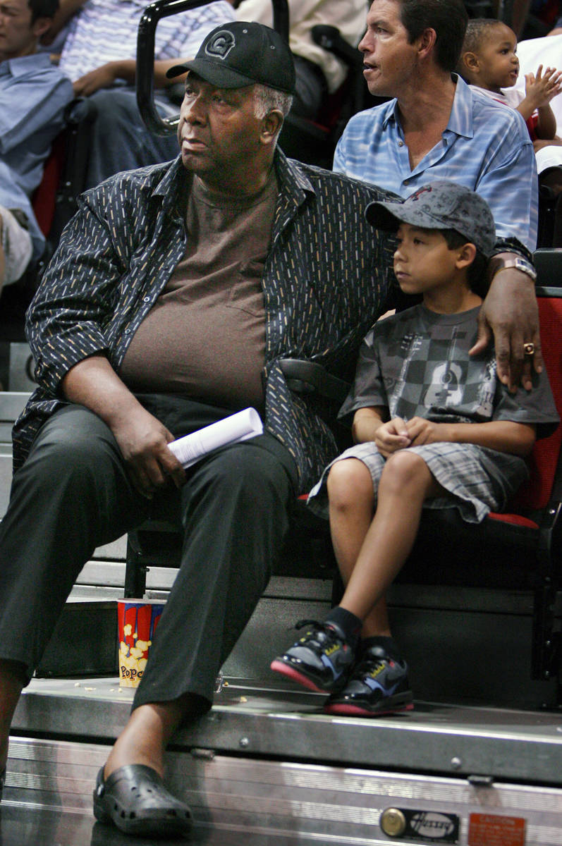 Former Georgetown basketball coach John Thompson, left, watches the Sacramento Kings play the T ...