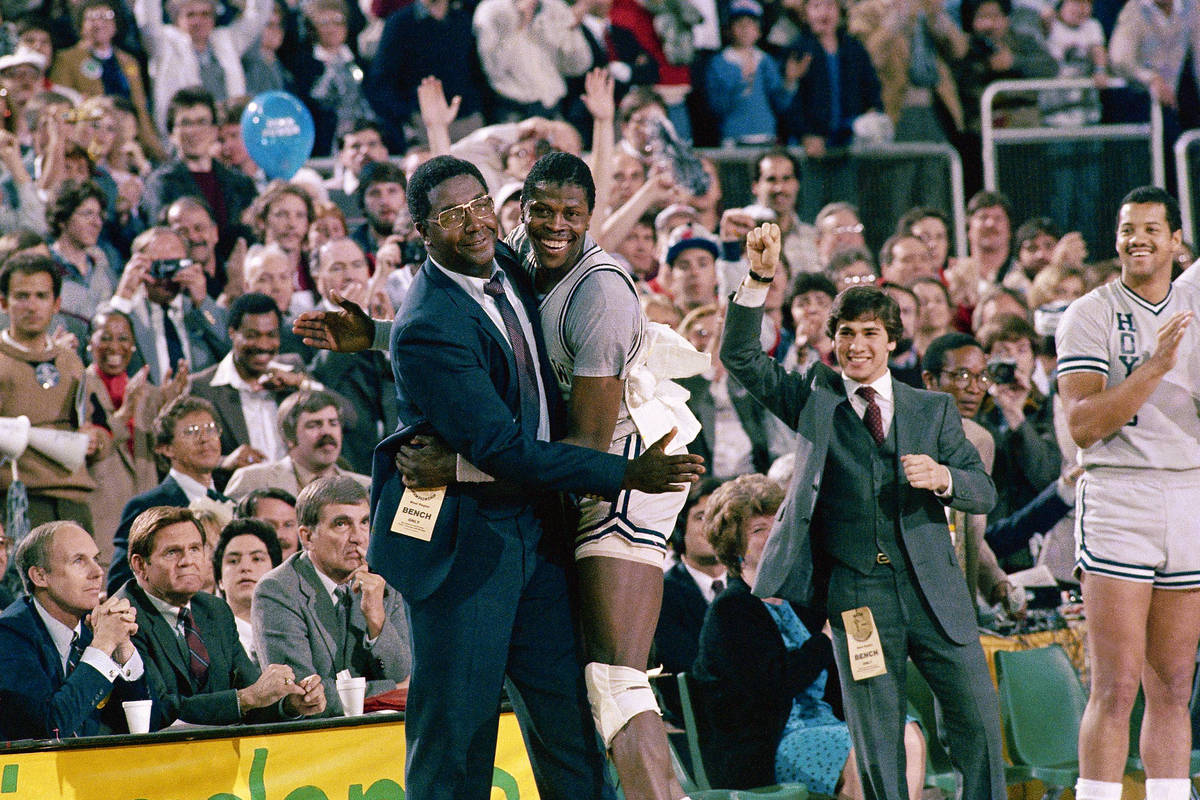 FILE - In this April 2, 1984, file photo, Georgetown head coach John Thompson, left, gives a ha ...