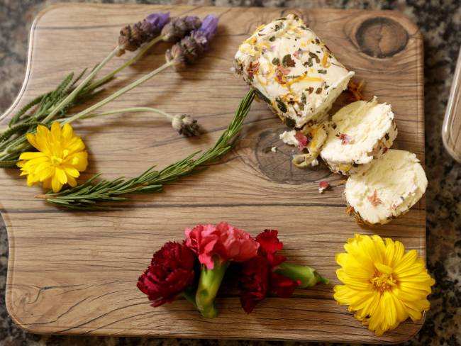 Jacquin Buchette aux Fleurs, a fresh goat cheese from the Loire Valley in France, is covered in ...
