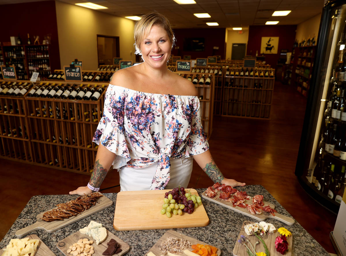 Cheese expert Diana Brier, the new owner of Valley Cheese & Wine in Henderson, prepares to asse ...