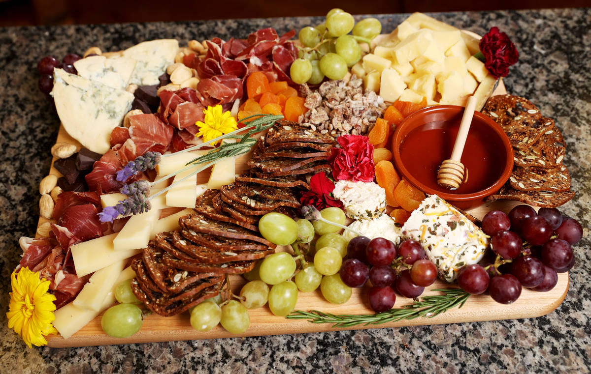 A good cheese board includes three to four cheeses that balance flavors and textures, delivery ...