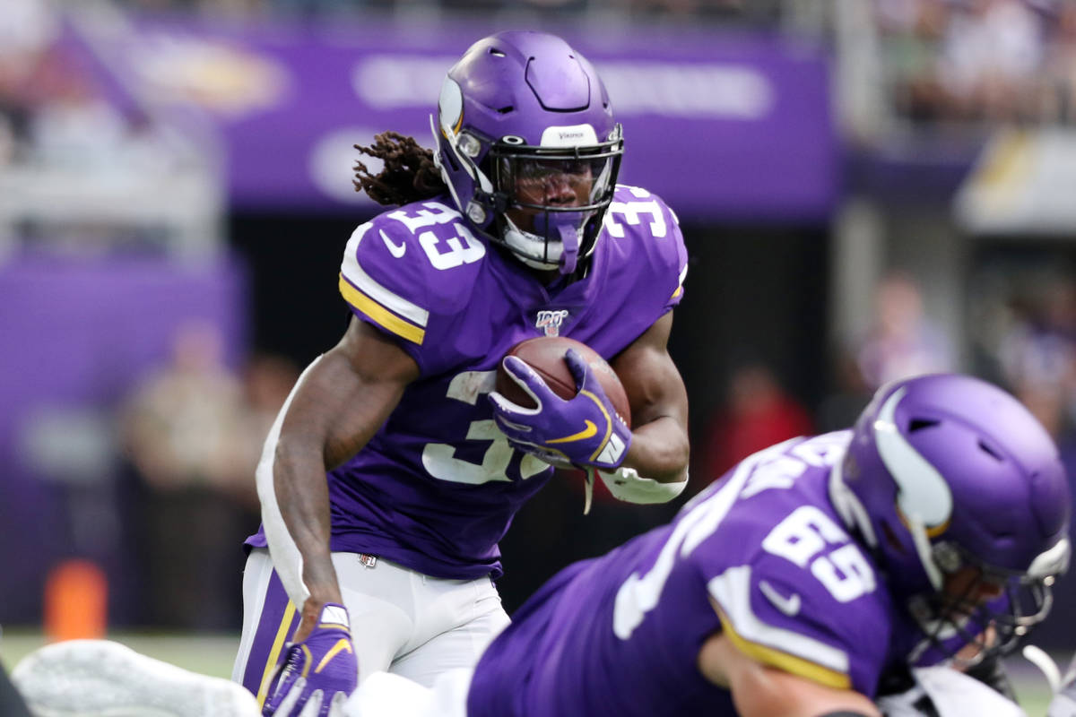 Minnesota Vikings running back Dalvin Cook (33) runs with the football during the first half on ...