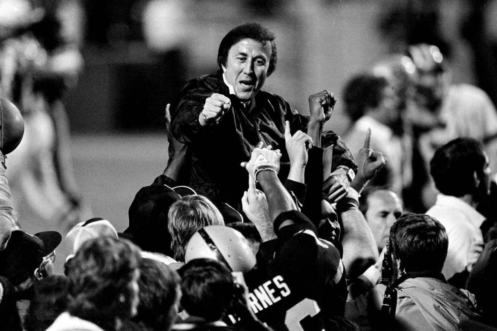 FILE - In this Jan. 23, 1984, file photo, coach Tom Flores gestures to members of the Los Angel ...