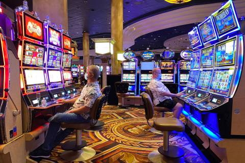 Gamblers don protective face masks at Caesars Palace on the Las Vegas Strip, June 24, 2020. (K. ...