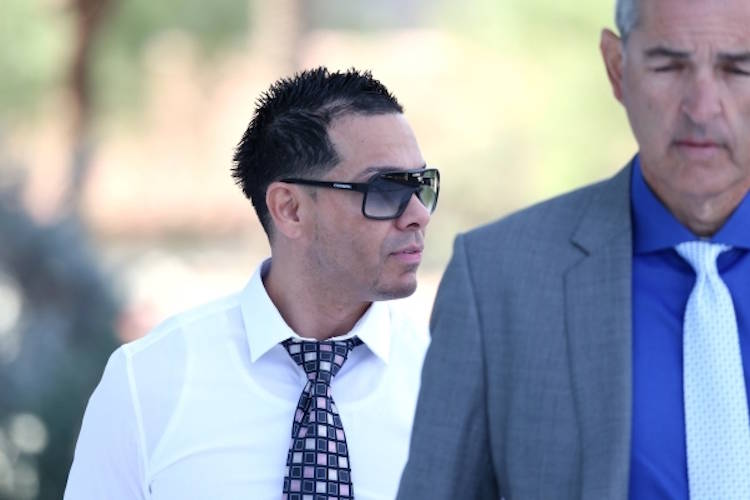 Ernesto Joshua Ramos, left, walks to Lloyd George U.S. Courthouse in Las Vegas with his attorne ...
