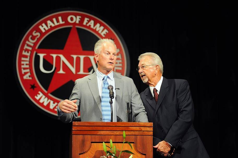 Kenny Mayne, left, speaks with Dick Calvert at the UNLV Athletics Hall of Fame induction ceremo ...