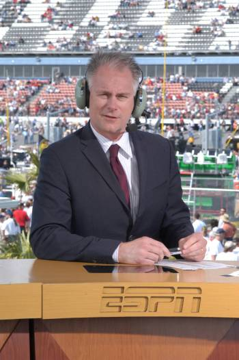 ESPN commentator Kenny Mayne is shown working on a remote studio set during coverage of the Day ...