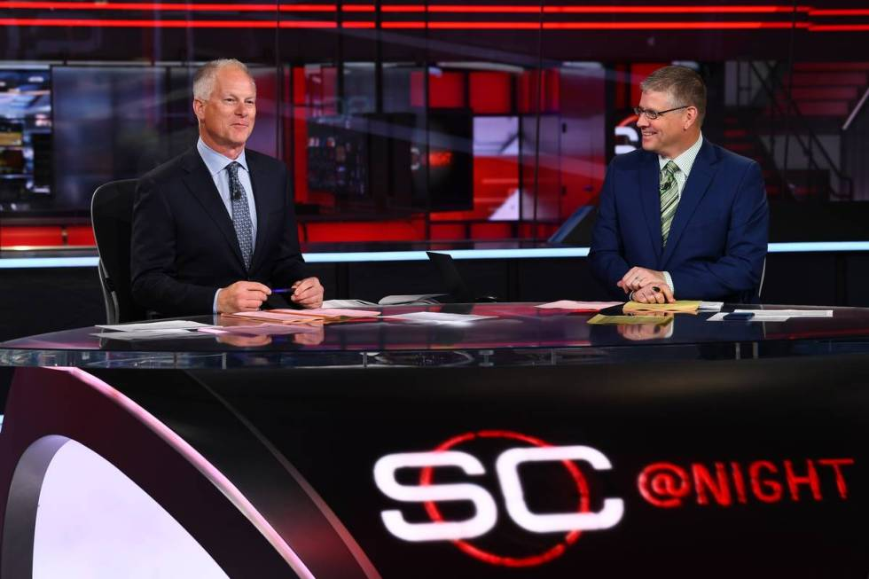 Kenny Mayne sits on the set of SportsCenter with co-anchor John Anderson. He has been at ESPN s ...