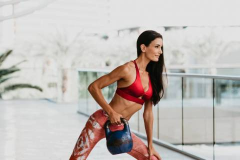 Lacy Schorr, Summerlin resident and fitness instructor at TruFusion, demonstrates her fitness t ...