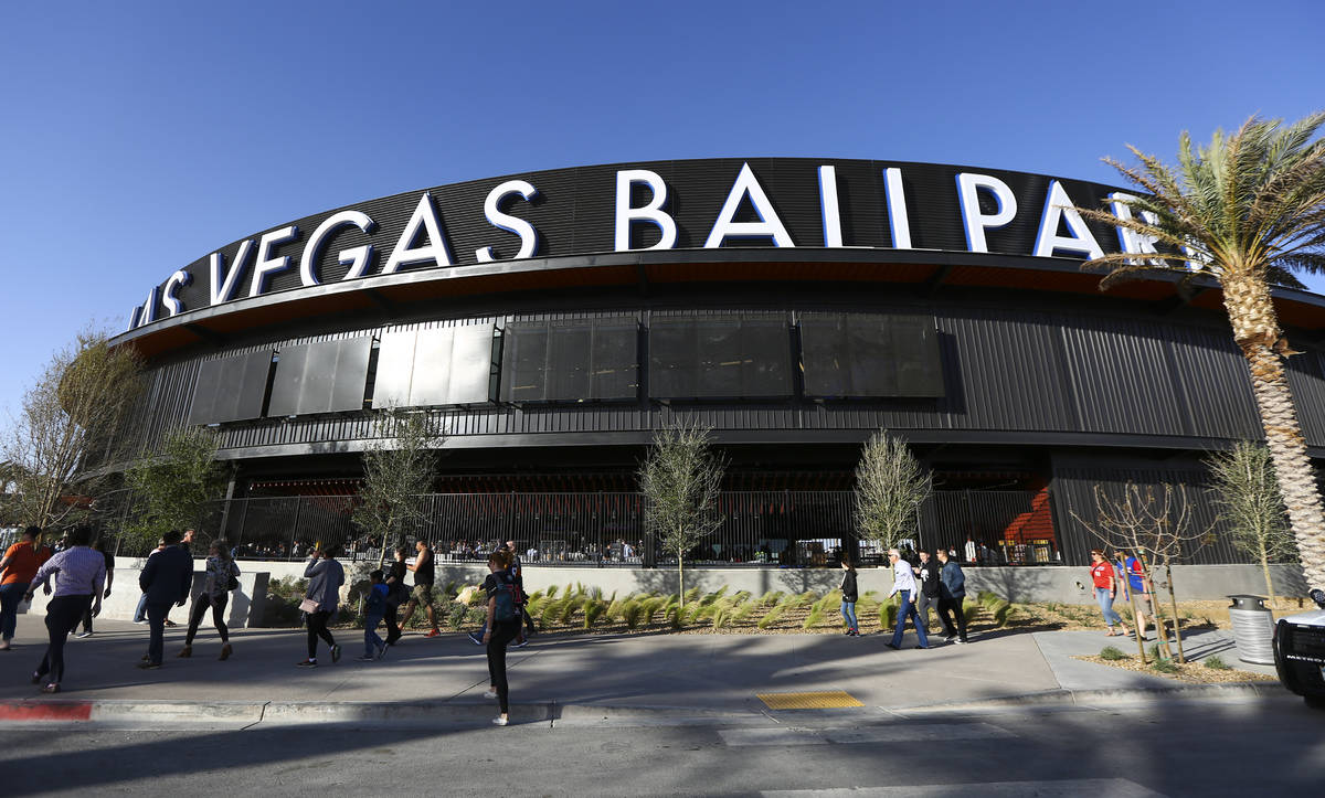 fans line up to enter the Las Vegas Ballpark for the Las Vegas Aviators' home opener in Downtow ...