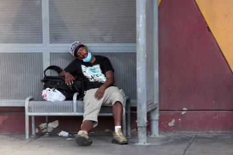 A person rests in the shade on Las Vegas Boulevard near Fremont Street Monday, Aug. 17, 2020. ( ...