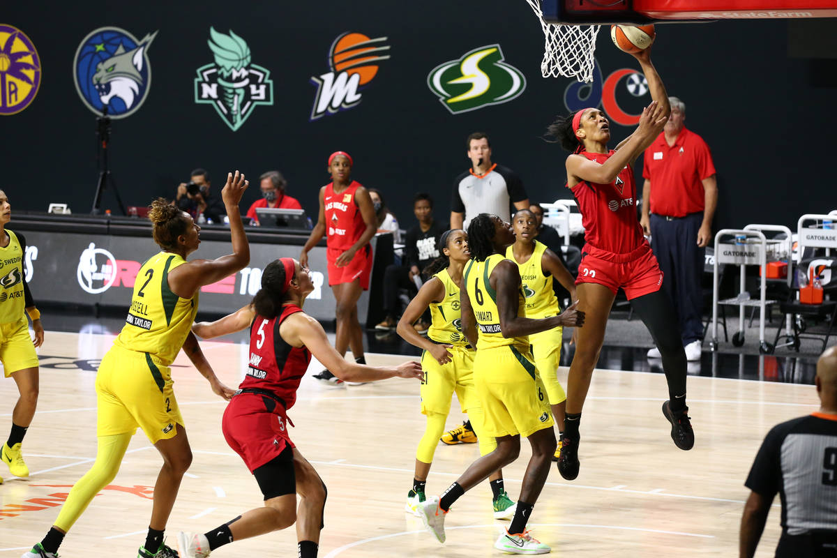 A'ja Wilson #22 of the Las Vegas Aces drives to the basket during the game against the Seattle ...