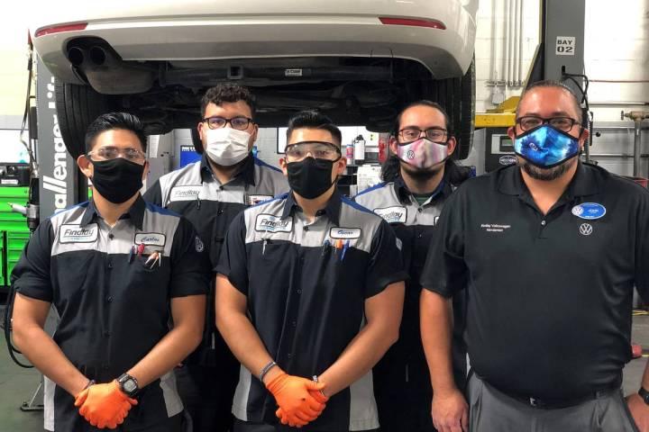 Findlay Volkswagen service director John Gonzalez poses with a few of his current technicians. ...