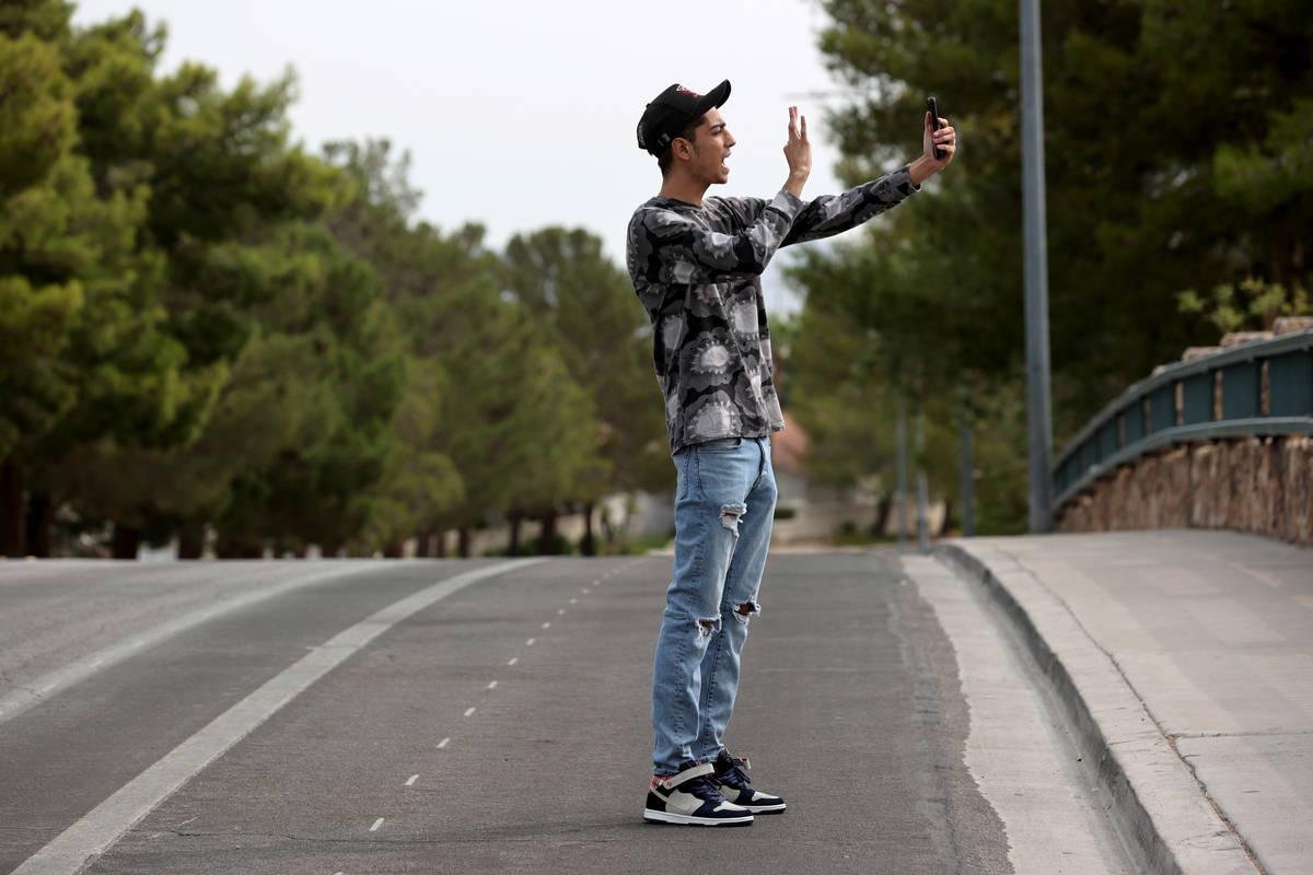 Eric Rivera, 25, of Las Vegas creates a TikTok video at Desert Shores in Las Vegas Friday, Sept ...