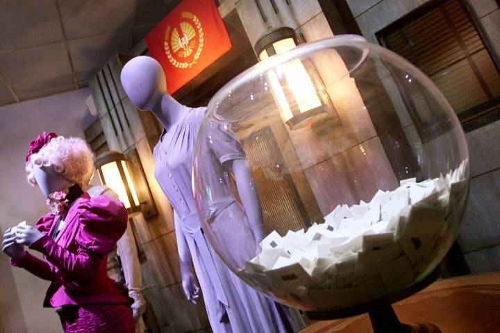 Costumes that were worn by Elizabeth Banks (left), Jennifer Lawrence (right) are on display as ...