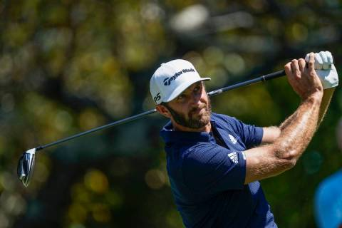 Dustin Johnson hits his tee shot on the fifth hole during the final round of the Tour Champions ...