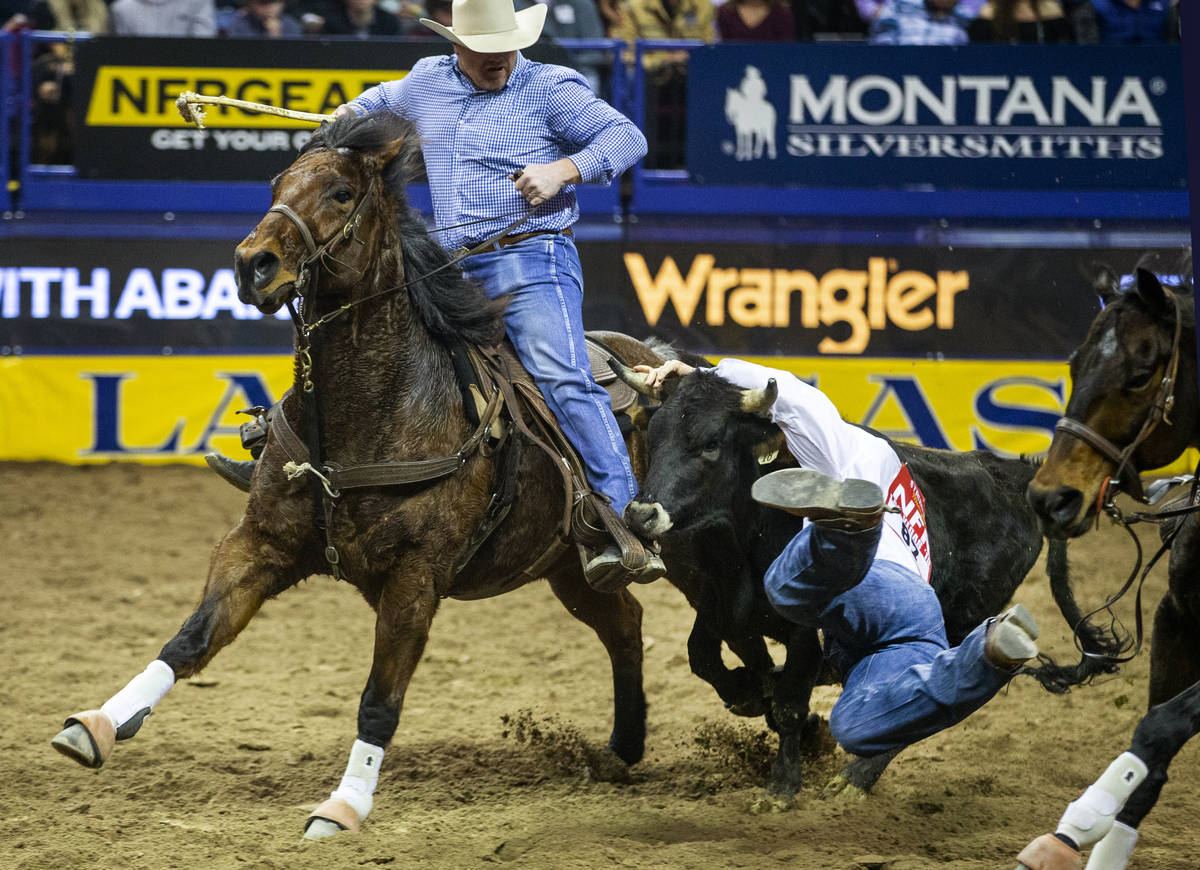 J.D. Struxness of Milan, Minn., mistimes the leap in Steer Wrestling during the tenth go round ...