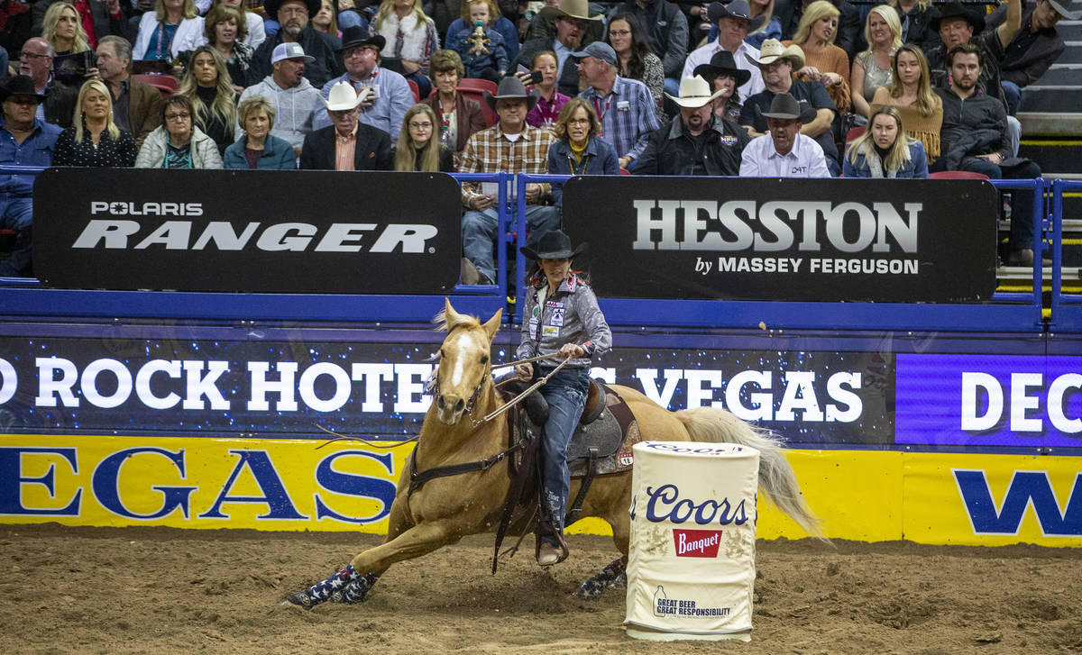 Jessica Routier of Buffalo, S.D., turns the corner in Barrel racing at the tenth go round of th ...