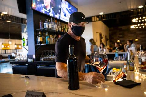 Bar manager David Cooper prepares a glass of wine during happy hour at Spaghetty Western in the ...