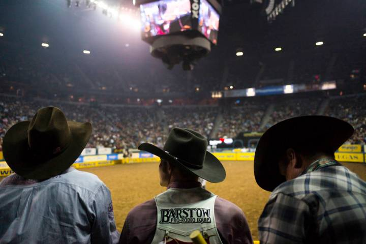 FILE - In this Dec. 8, 2017, file photo, contestants and officials watch competitors in the bar ...