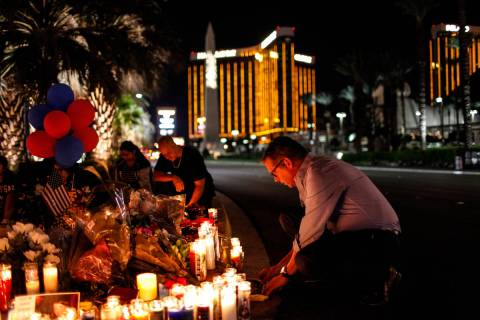 Jim Synder of Las Vegas attends a vigil in remembrance of the mass shooting victims along the S ...