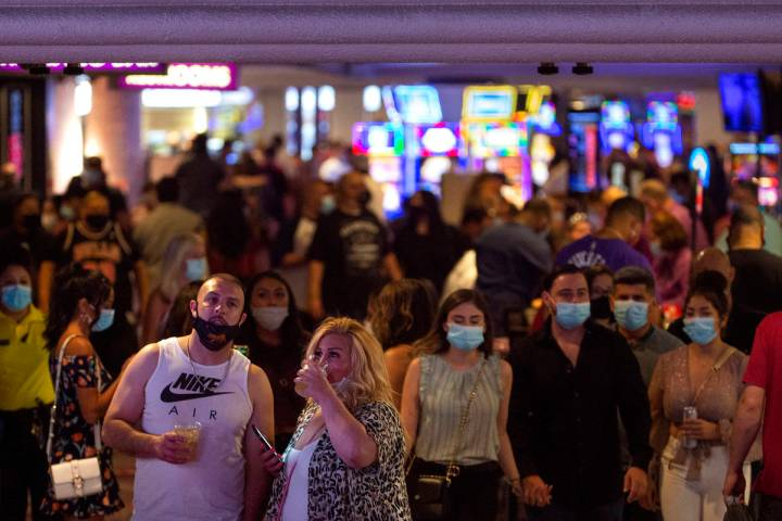 People mill around Harrah's on the Las Vegas Strip during Labor Day weekend, Sept. 5, 2020. (El ...