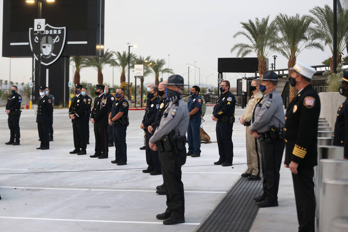 Multi-agency emergency responders participate during a 9/11 ceremony at Allegiant Stadium in La ...