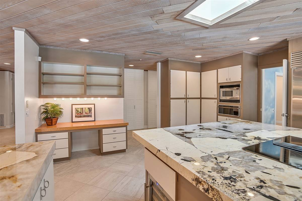 The kitchen has a small built-in desk. (Nartey Wilner Group)