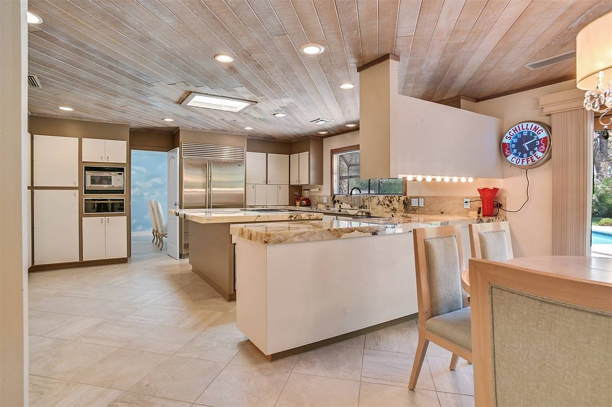 The updated kitchen in Andrew Dice Clay's historical home has new granite, updated appliances a ...