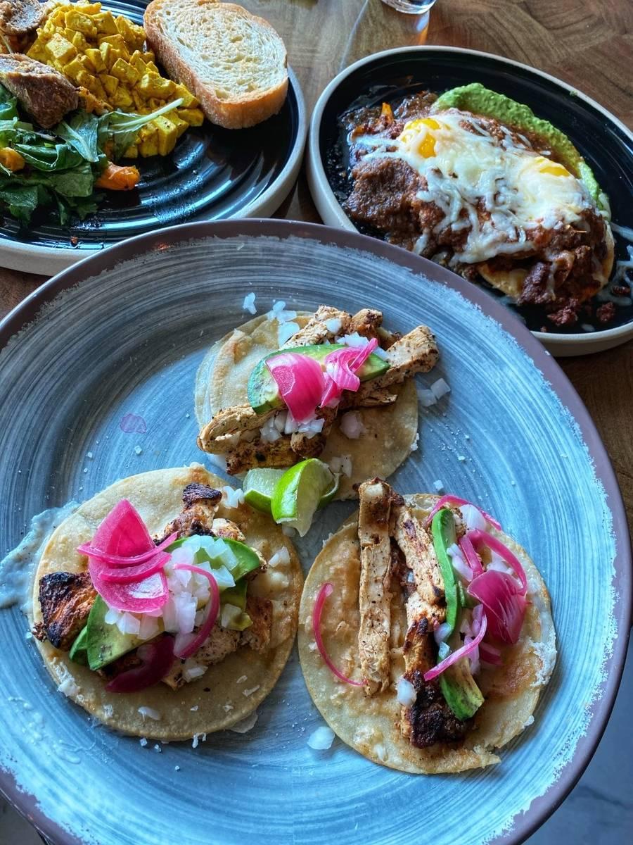 Clockwise from front, vegan chicken tacos, vegan bratwurst and eggs and huevos ranchero. (JMP F ...