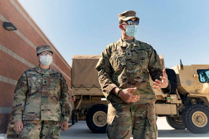 Specialist Iris Ramirez, left, and Specialist Karim Arafa discuss the mission of delivering per ...
