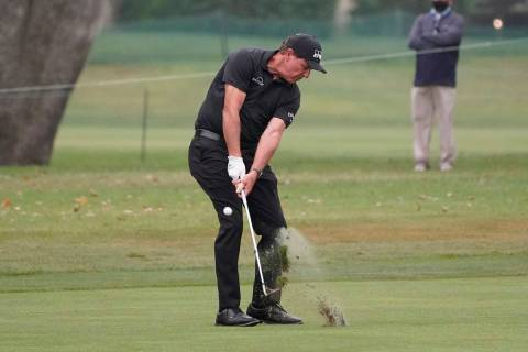 Phil Mickelson hits his approach shot to the 18th green of the Silverado Resort North Course du ...