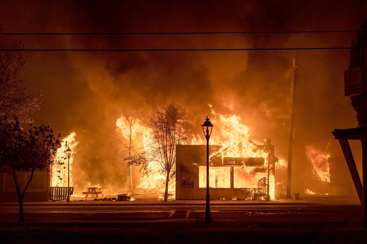Buildings are engulfed in flames as a wildfire ravages the central Oregon town of Talent near M ...