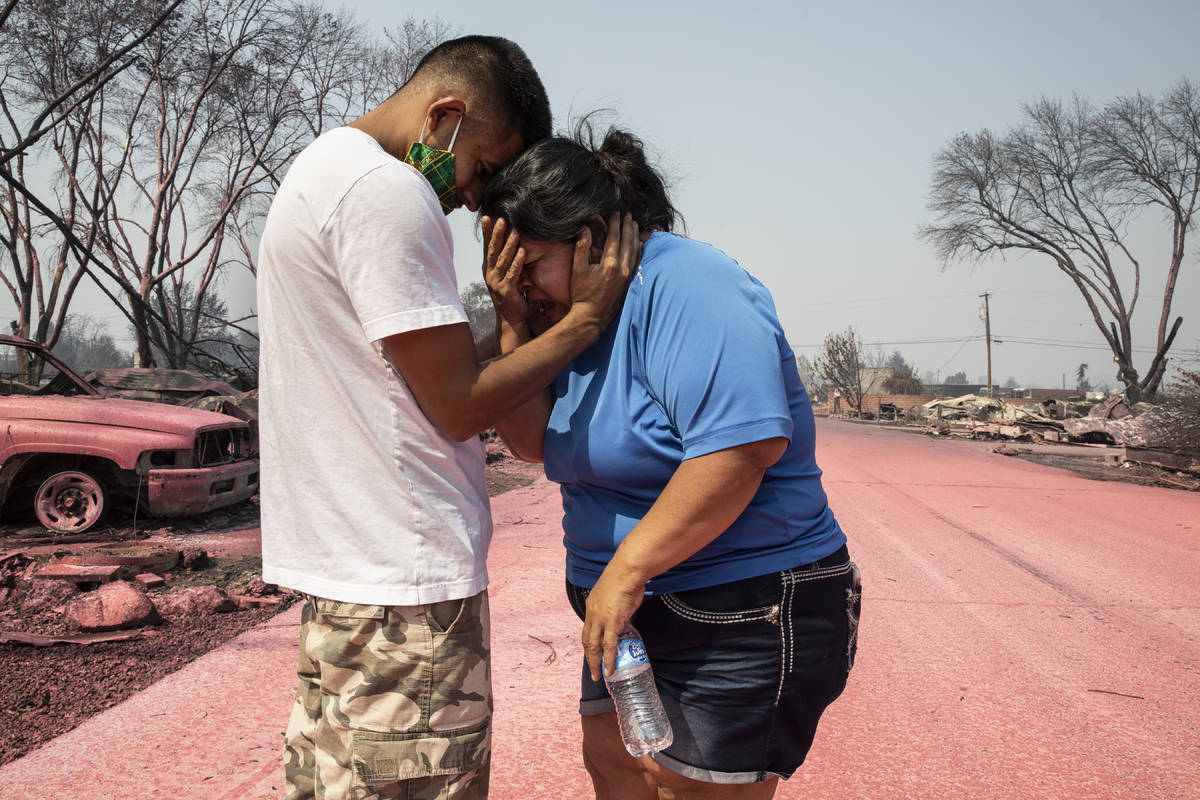 Dora Negrete is consoled consoled by her son Hector Rocha after seeing their destroyed mobile h ...